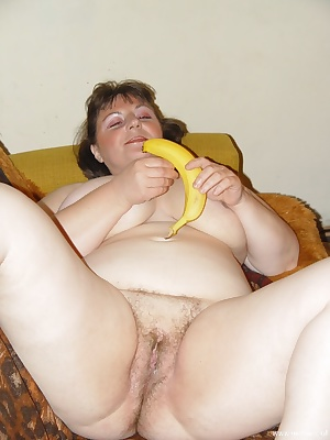 Chubby housewife playing with some vegetables and fruit
