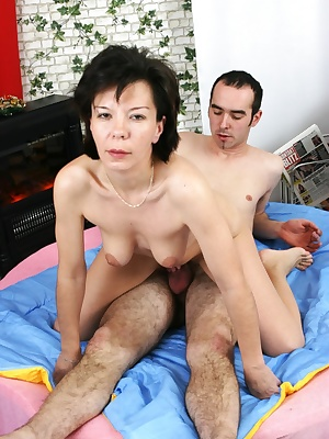 This older broad loves a hard throbbing cock