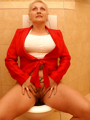 She sucks, licks ass and takes cum on the crapper