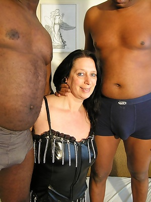Horny mature slut doing two black dudes