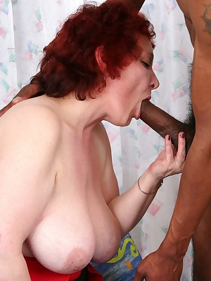 Chubby mature fucing and sucking a black dude