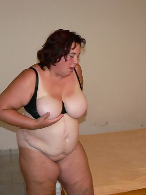 chubby mature slut playing with a huge toy