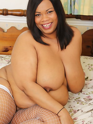 Big breasted British black mature bbw is getting naughty