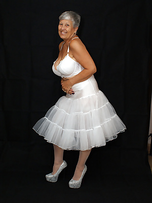 Hello guysLooking gorgeous in my white frilly petticoat and white undies  come and have a look x