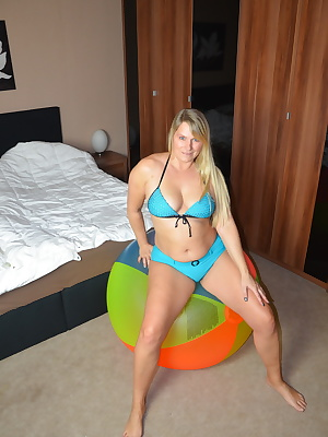 Naked with a I huge pose beach ball naked and in various positions