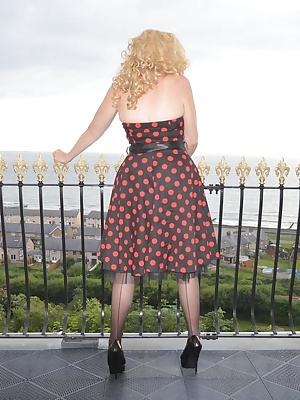 Barby dresses up for evening meal at the posh hotel and cant resist stripping on the balcony for anyone to see.