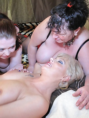 Pictures of Dimonty, Busty Kim, Chesirefungirl and Tempest Ravon having 4 girl fun on a large bed.Includes close ups, di