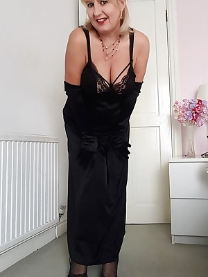 Lady-like in my long Black negligee.  Im wearing long black satin gloves, pretty French Lace panties, fully fashioned st