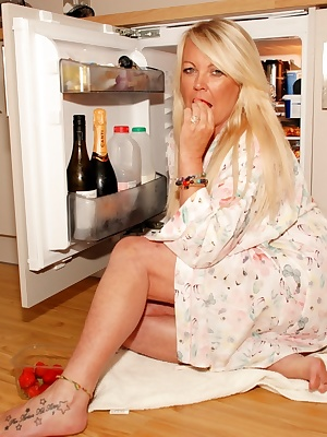 Naughty Nicky , a gorgeous sexy milf, has been caught raiding the fridge so we decided that if she loves strawberries an