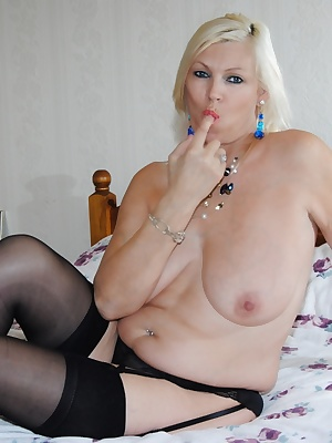 Various pictures of Platinum Blonde showing of her mature tits and shaved pussy. Only wearing my stockings and suspender