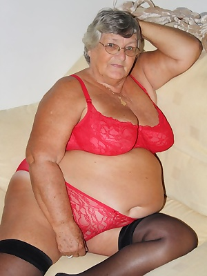 Libby showing off her favourite colour again with this red set of lingerie and black stockings.  Red lacy bra and skimpy