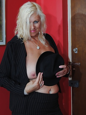 Platinum Lady continues the strip the panties come off and the tits continue to be flashed, as well as her sexy shaved p