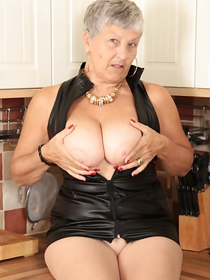 Hello guysGetting saucy in my friends kitchen  couldnt resist showing off my black leather dress and gorgeous red shoes