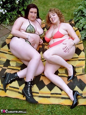 Sometimes it's nice to relax and chat while in the garden sunbathing with a girlfriend such as Kinky Kelly, although of