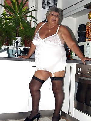 Theres no telling when Grandma Libby will feel sexy  Working in my kitchen wearing only my white corsselete and black st