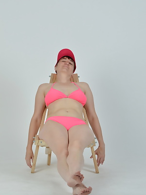 Posing in a recliner with bikini and cap.All in beautiful Neon Pink.A horny desired by a user.