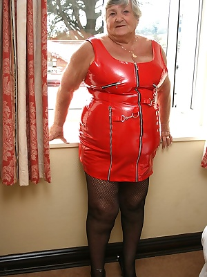 Tight red PVC clings provocatively to Grandma Libbys ample curves  I could only just squeeze into this dress so it was q