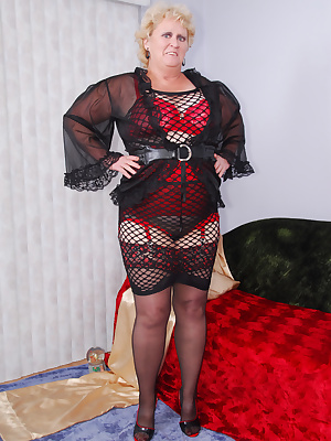 Mmm, this wide net black dress is sooo revealing... perfect for showing off my red lacy bra and girdle underneath - To c