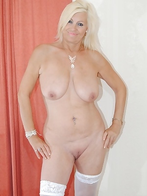 Pictures of me Naked except for my stockings shoes and suspenders. Check out my shaved pussy.
