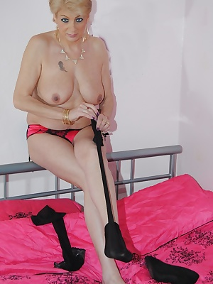 In this set of pictures I am just wearing a pair of red and black panties which I remove to reaveal my wet moist mature
