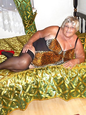 If you like to see Grandma Libby fucking herself with a big black dildo then come on in and join me.  Tight animal print