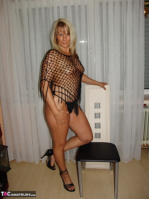 In the net shirt I'll show me and open my wet pussy for you.