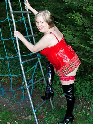 Hi Guys Im wearing my Sexy Red  Black PVC outfit for this photoset and my Tartan Micro skirt with Black PVC Boots and Im