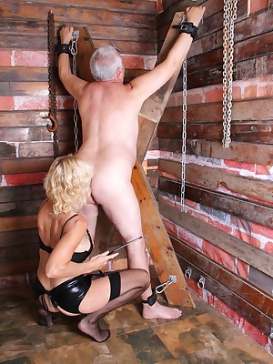 Dimonty and Molly Maracas are dressed in there PVC bondage gear and strap there victim to whip and abuse him.