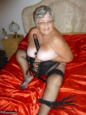 Sexy basque and black fishnets stockings get me in the mood for a good hot session on my red satin sheets.  Why dont you