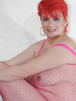 Dressed in my pink crutchless fishnet bodystocking with right red hair.
