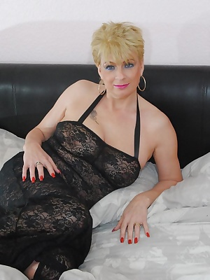 Dressed only in my sexy black see through negligee I pose so you can see how sexy I look in it before starting to strip