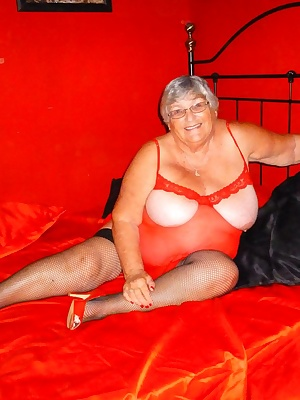 Grandma Libby gets hot hot hot in her red bed and red outfit.  All that is missing is a guy with a big cock to help me o