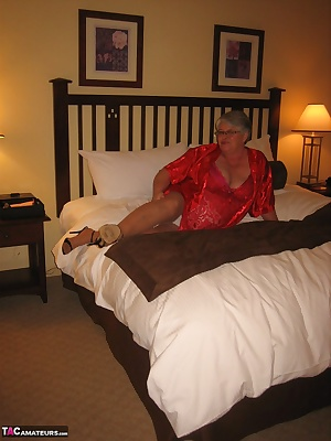Pantyhose, big titties, and one horny Girdlegoddess. Spread out on that big bed in her sexy red lingerie.