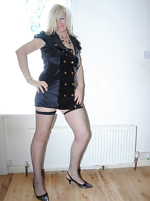 Photos of me dressed in my PVC dress. Then stripping off to reaveal my black bra and panties. Finally I strip of my bra