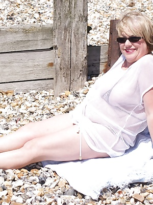 Hi Guys It was a nice day so down to the beach at Lea-On-Solent for a quick Photoshoot in my Leopard Print Micro Bikini,