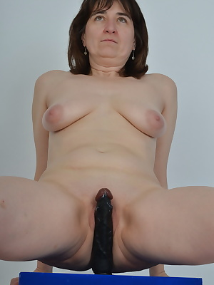Blue box, black Dildo and I with far spread legs.Slowly the black Dildo disappears in myPussy.When he comes back you can