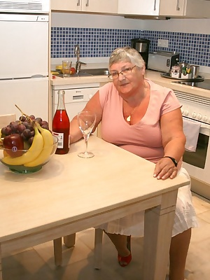Time for Grandma to relax in the kitchen with a bottle of wine and a bowl of fruit.  Wine and fruit  Does that give you