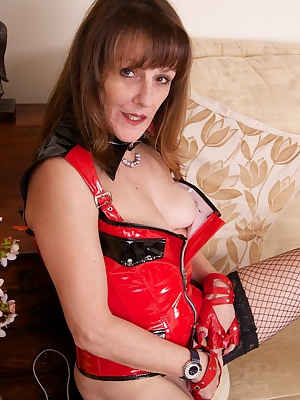 Hi Guys I wearing my Red PVC Basque my Black Fishnets and my black ankle boots but its time to play so its Tits out, Kni