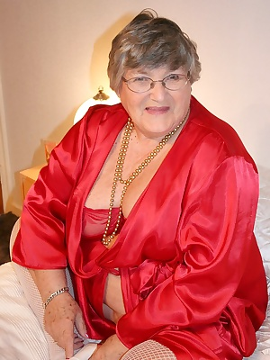 Red is my favourite colour so here I am wearing my red satin robe with white stockings and using a red dildo to pleasure