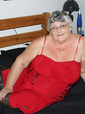 Grannys favourite red dress and black stockings.  It looks good when I am fully dressed  but even better as I strip it o