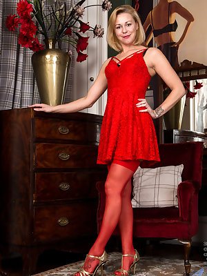 Looking hot as hell in a little red dress, Lucy Lauren flaunts her certified hot body for your pleasure. Beneath her saucy clothes hide sheer panties and a bra that lovingly hugs her small breasts. As her clothes come off to reveal soft skin, the juicy mo