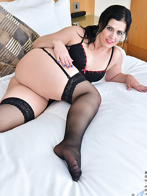 Spanish cougar Montse Swinger is ready to rock your world with her perfect-handful all naturals and her juicy rump. After teasing her bare fuck hole with pressure from her thong, she peels her underwear off and spreads her legs in preparation for a pussy