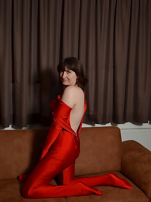 Posing in the red Lycra whole body suit. On the sofa pose I to my photographer in the cool suit. This gives for the mome