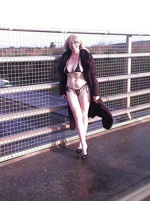 Barby out in her mini bikini on the bridge over M6 Toll Road