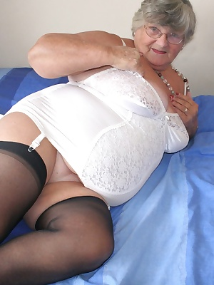 Do you like to see Granny in her corsets  If so you are in for a treat here as I strip top show you my white satin  cors