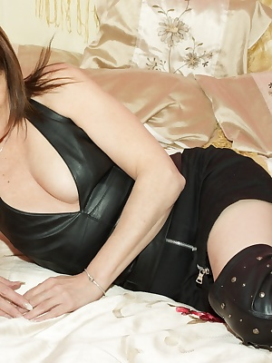 Im all in Leather for you Boys, Leather Skirt, Top and Thigh High Boots and skimpy little black knickers, now theres not