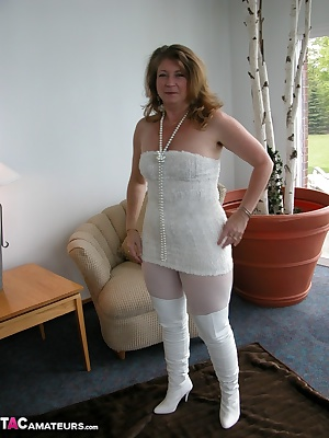 Devlynn shows a change of pace here with an all white Snow Princess look. White furry dress, white pantyhose paired with