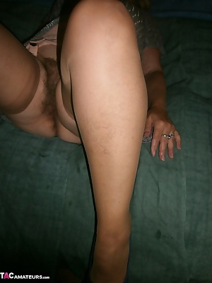 Here you see me in stockings with skin colour. My hairy legs appear out of the stockings.It is so cool slowly to caress