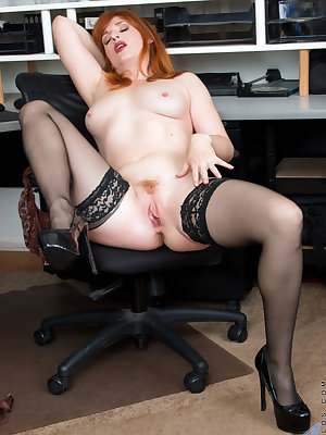 Our favorite redhead milf is back with another round of fun as she gets down and dirty in the office. Spreading her legs, she peels off her panties and bra. Once she's down to her high heels and stockings, this lusty mom will stop at nothing when it comes