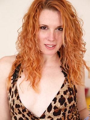 Wild and crazy redhead Monita loves to pull off her miniskirt nightie and play with toys! This horny mom's favorite is a big dildo that she titty fucks as foreplay and then slides deep into her cum craving fuck hole that Monita will do anything to fill an
